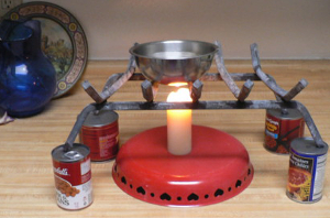 canned goods worked to raise the fireplace grate above the candle