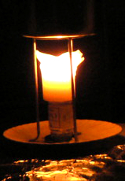 Pillar candle walls expanding outward, but still holding the melted wax
