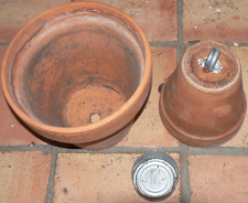 Clay pots and empty tin from canned chicken breast